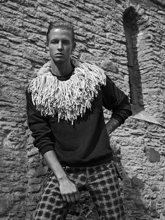Sander wears scarf Kristel Kuslapuu, pullover Projekt and trousers Kalle HT.