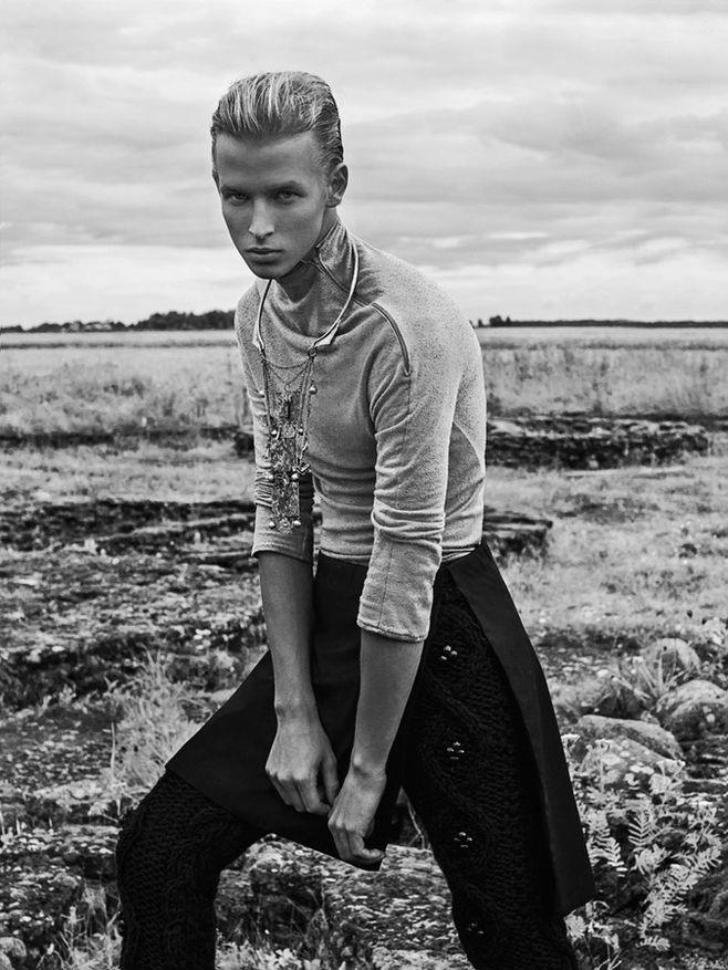 Sander wears top Kalle HT, knitted trousers Kristel Kuslapuu, kilt Projekt and necklace Kirill Safonov