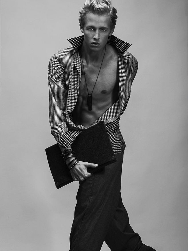 Sander wears shirt Kirill Safonov, trousers Kalle HT, chain Projekt, leather wristband Stella Soomlais and laptop case Portel.
