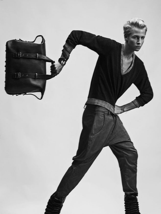 Sander wears pullover and trousers Kalle HT, leather watch and bag Stella Soomlais.