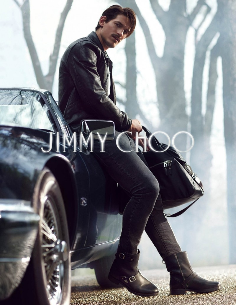 Model Jarrod Scott stars in Jimmy Choo's campaign that features harness style moto boots.