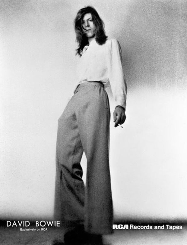 David Bowie is tres chic in a fitted top and wide-cut trousers, while promoting Hunky Dory.