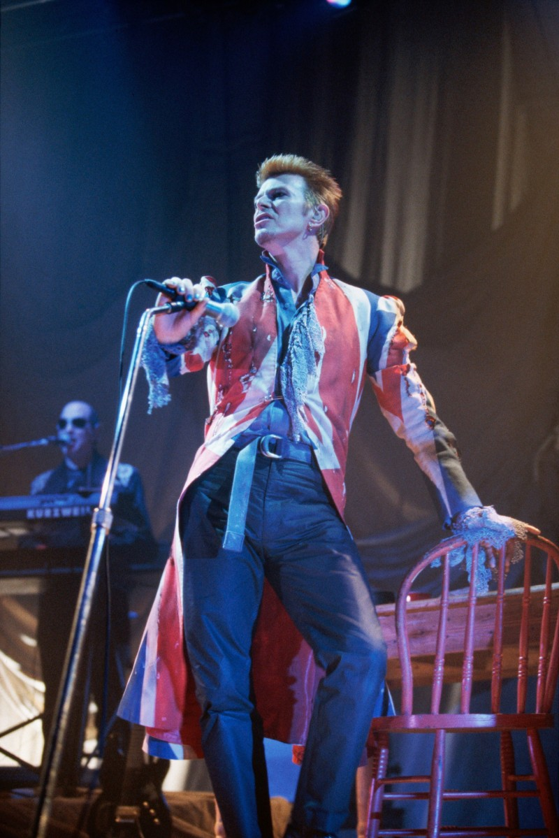 David Bowie performs in 1996 Roseland, wearing a Union Jack coat designer by Alexander McQueen.