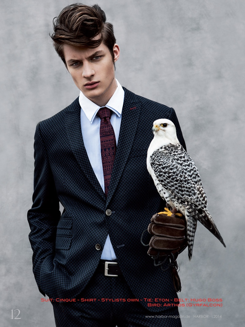 dino busch poses with owls for harbor magazine the