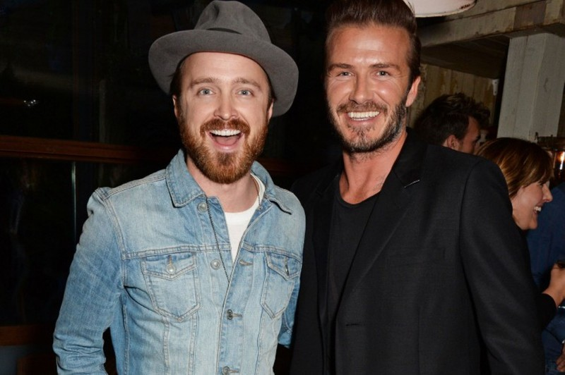 Actor Aaron Paul poses with David Beckham