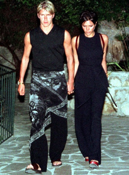 Captured on June 2, 1998, David Beckham caught attention, wearing a sarong as he and Victoria visited a restaurant in the south of France.