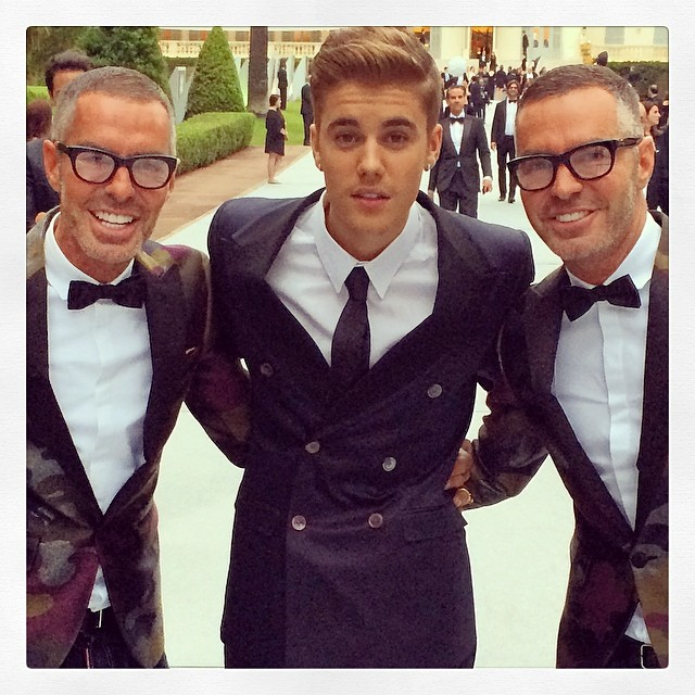 Dsquared2 designers Dan and Dean Caten pose with singer Justin Bieber at the amFAr Gala