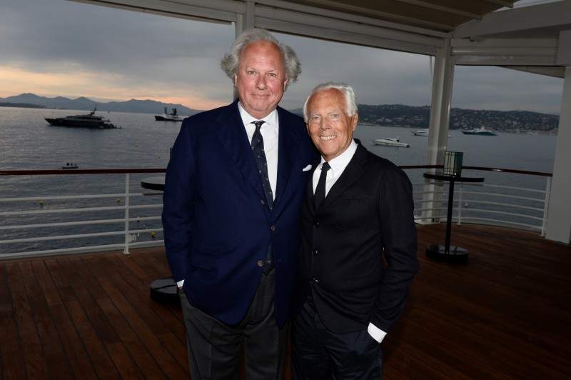 Co-hosts for the evening, designer Giorgio Armani poses with Vanity Fair editor-in-chief Graydon Carter