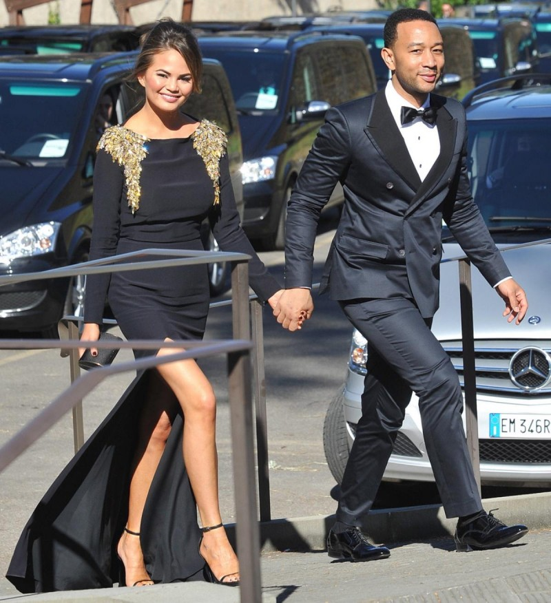 Singer John Legend and his wife Chrissy Teigen attend Kim Kardashian and Kanye West's wedding