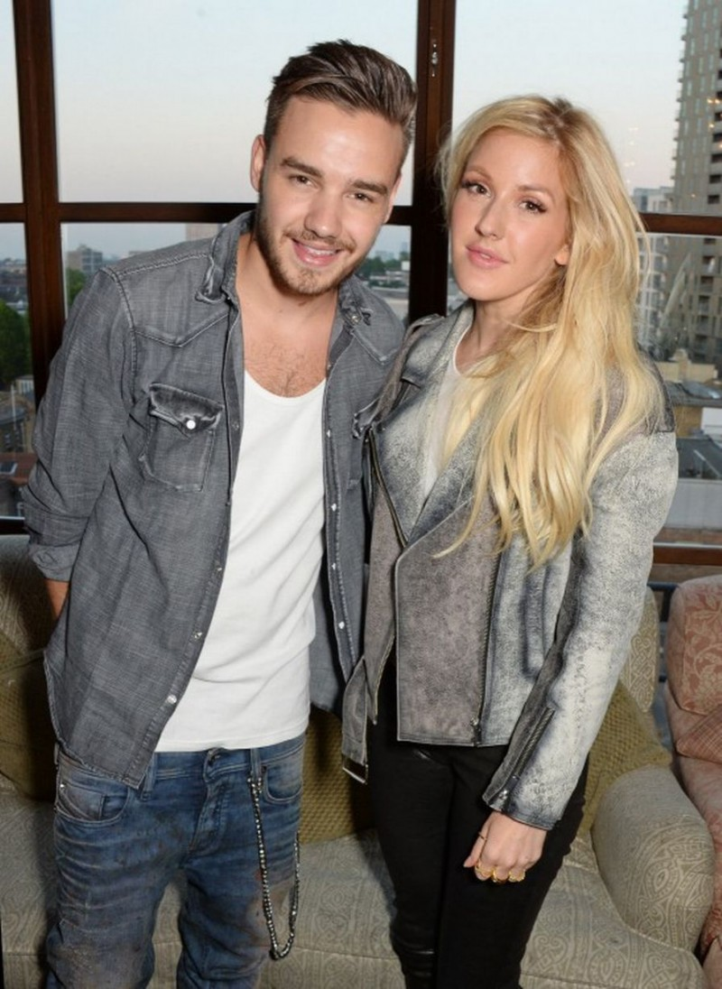 One Direction member Liam Payne poses with singer Ellie Goudling