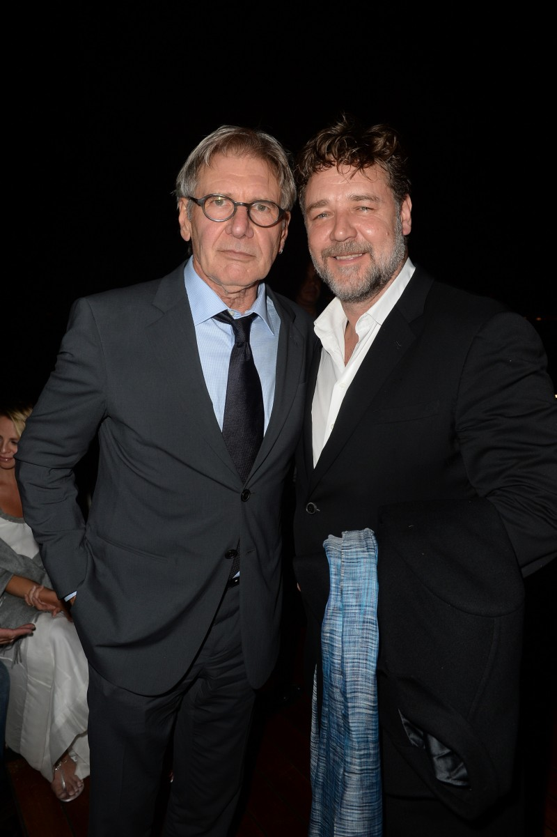 Actors Harrison Ford and Russell Crowe pose for a photo together, both dressed in Giorgio Armani