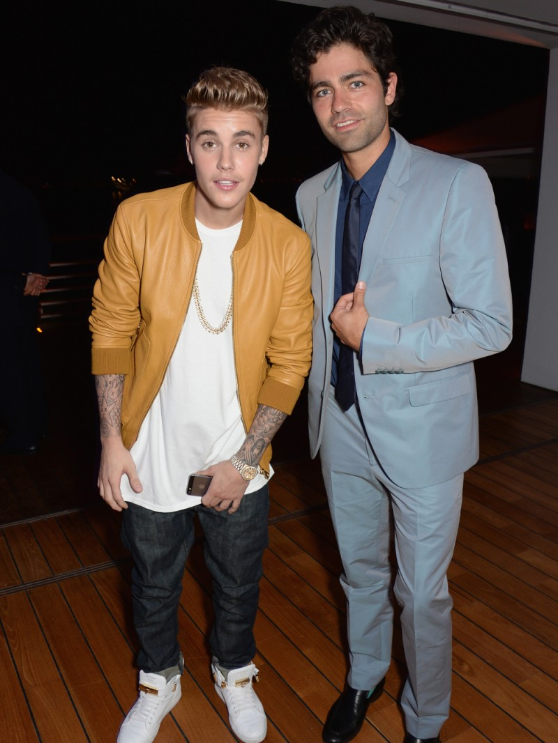 Singer Justin Bieber and actor Adrian Grenier pose. While Grenier sported a suit for the event, Bieber looked like a party crasher in a leather bomber.