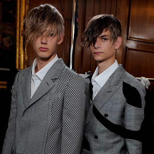 Models pose backstage at Alexander McQueen's London show.