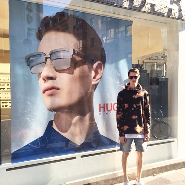 Andrew Westermann poses for a photo in front of his Hugo Boss campaign.