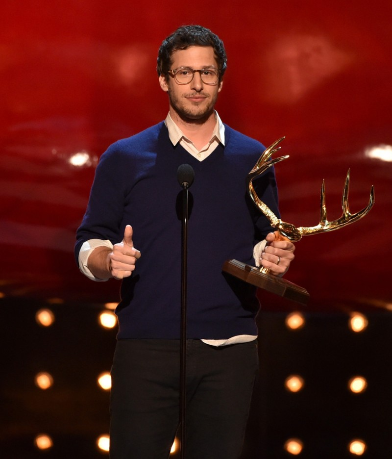 Andy Samberg was smart but strategically disheveled in a sweater and dress shirt.