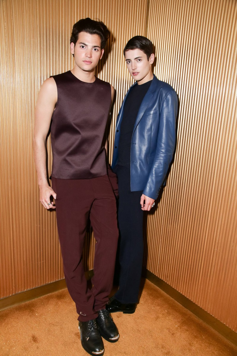 Harry Brant and Peter Brant Jr. pose for a photo, wearing looks from Dior Homme