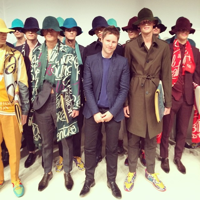 Designer Christopher Bailey poses with models backstage at his latest show for Burberry Prorsum.