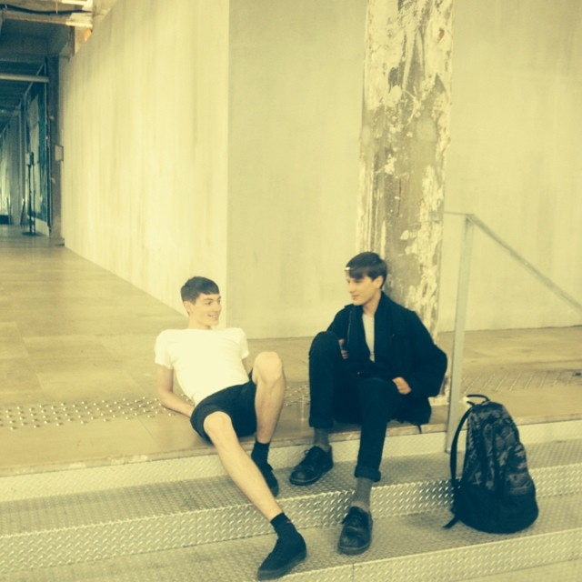 Models relax behind the scenes of Carven's Parisian show.