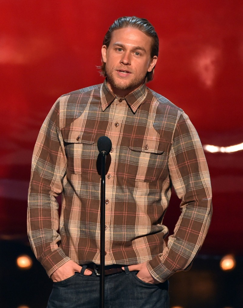 'Sons of Anarchy' star Charlie Hunnam didn't differ greatly fro his character in an oversized plaid shirt jacket.