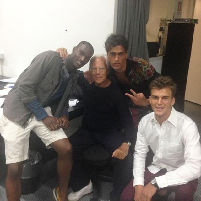 Corey Baptiste, Fabio Mancini and Patrick Kafka pose backstage with designer Giorgio Armani.