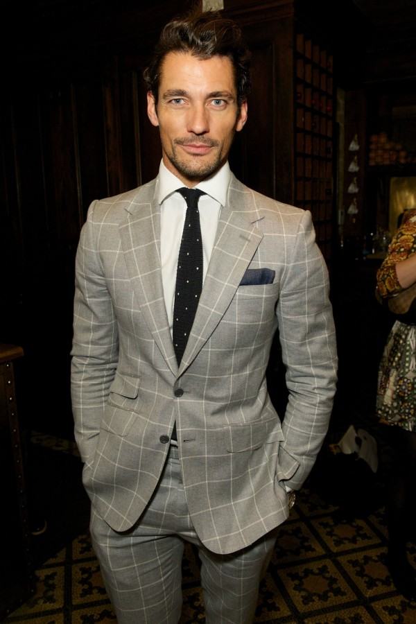 David Gandy wears Tommy Hilfiger windowpane suit to the designer's private fashion week dinner.