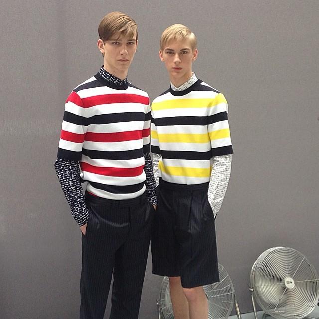 Models pose backstage at Dior Homme.