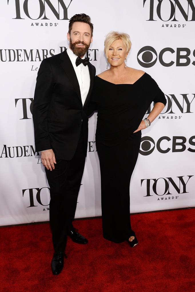 Man of the evening Hugh Jackman poses on the red carpet with his wife Deborra Lee Furness.