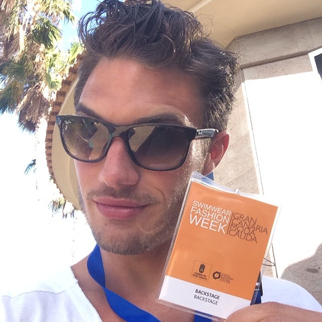 Jabel Balbuena shows his backstage access pass.