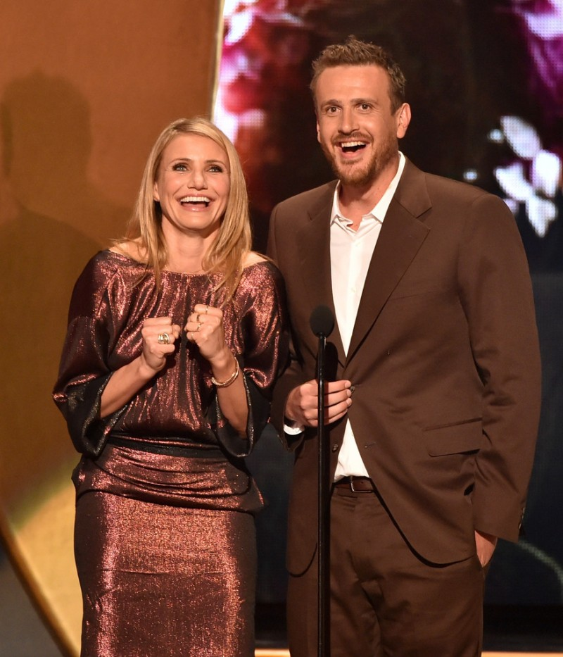 Actor Jason Segel, refined in a chocolate brown suit presents with actress Cameron Diaz