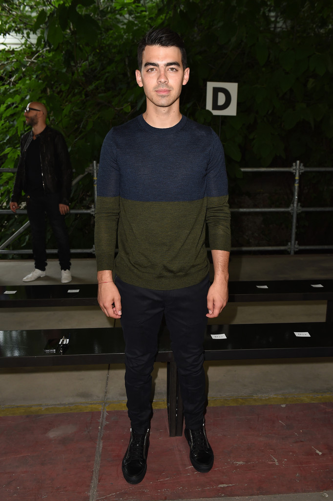 Playing it cool and casual, Joe Jonas hit up Diesel Black Gold's spring/summer 2015 show in a color blocked sweater with plain trousers.