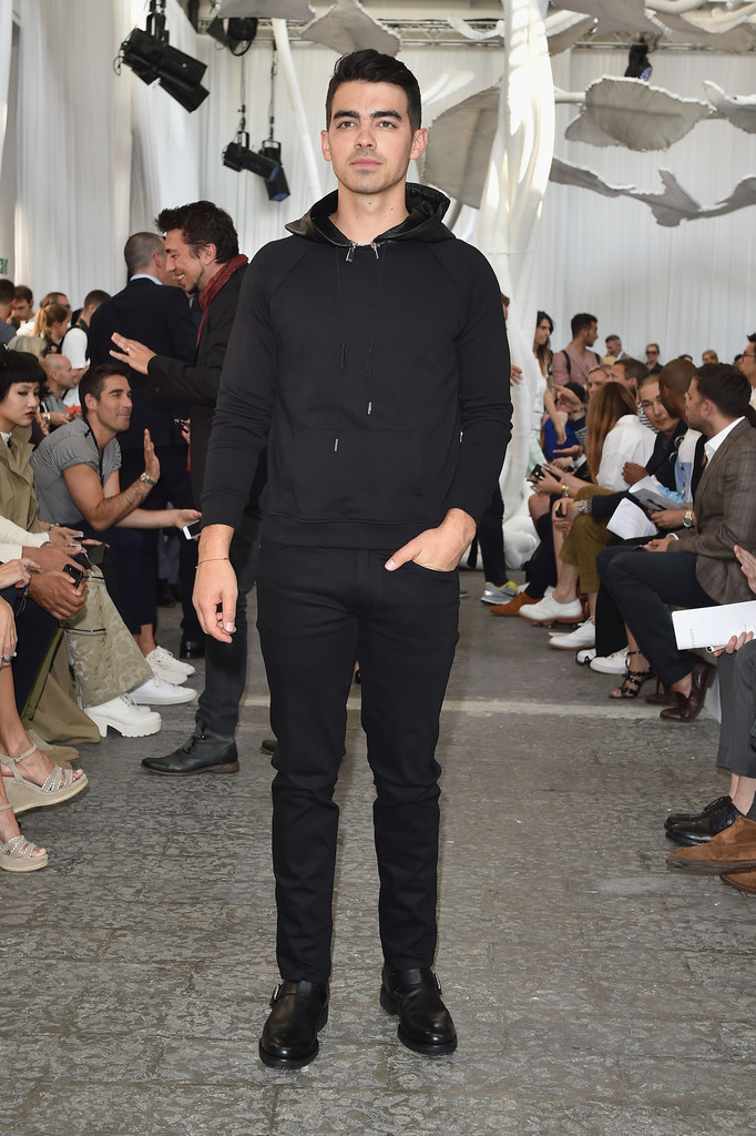 Understated in a black hooded pullover and pants, Joe Jonas was a front row guest at John Varvatos' latest show during Milan Fashion Week.