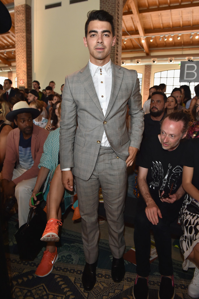 Joe Jonas pulled out another  tailored look, wearing a suit to Missoni's spring/summer 2015 show in Milan.