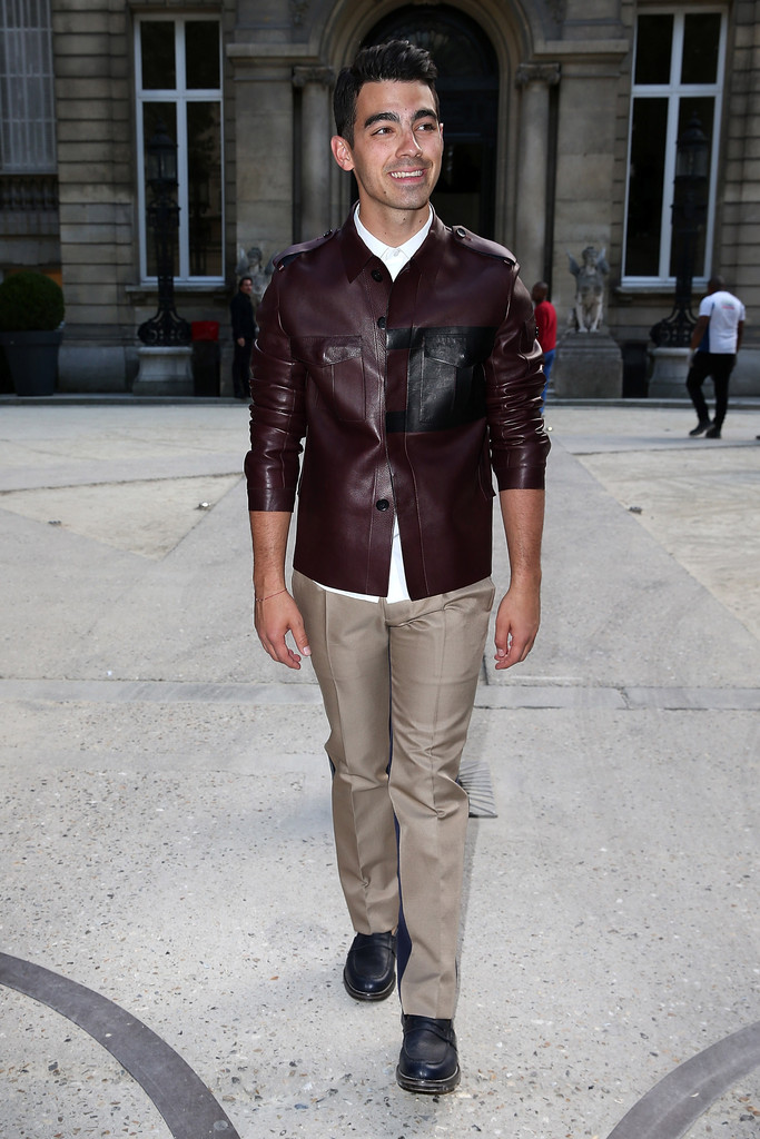 Joe Jonas played it bold in Valentino's signature leather wears, attending its spring/summer 2015 show in Paris.