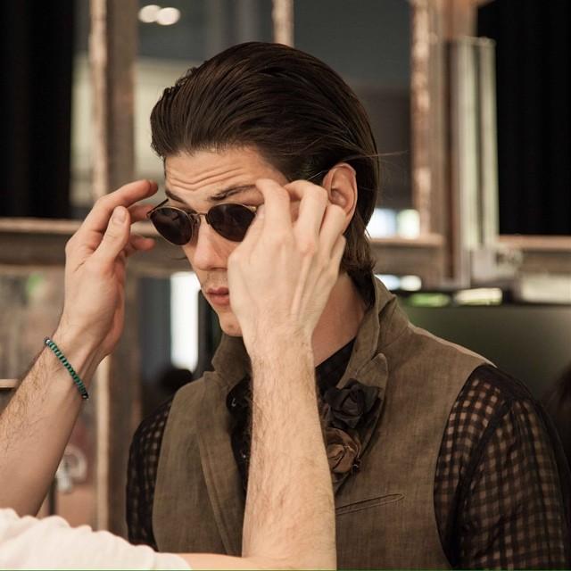 Model Simone Nobili gets new shades at John Varvatos' show during Milan Fashion Week.
