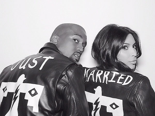 Kanye West and Kim Kardashian in BLK DNM 'Just Married' jackets.