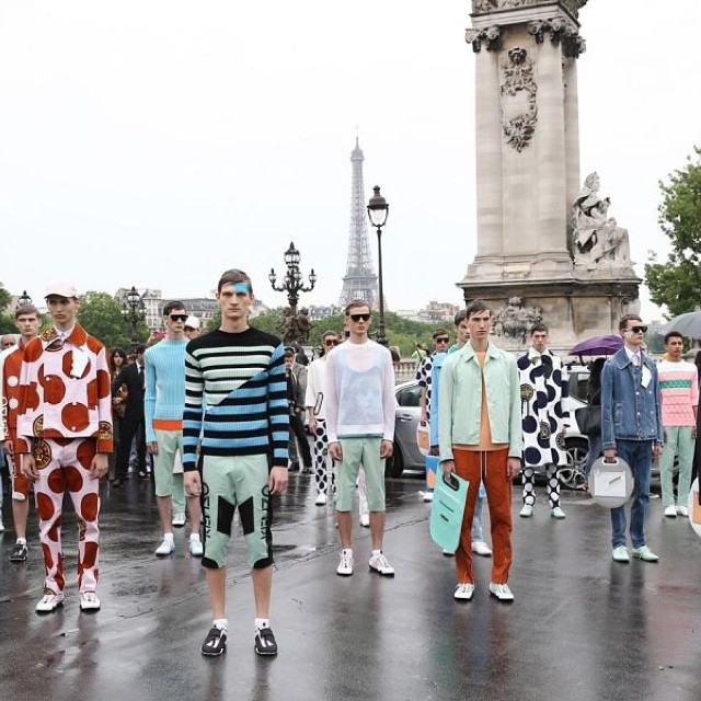 Models head out on a rainy day for Kenzo's spring 2015 show.