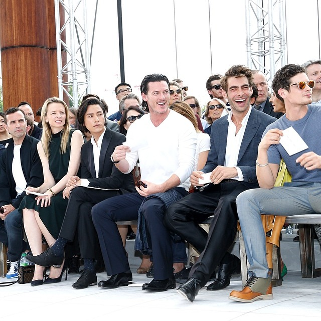 Actor Luke Evans and model Jon Kortajarena are all smiles front row at Louis Vuitton.