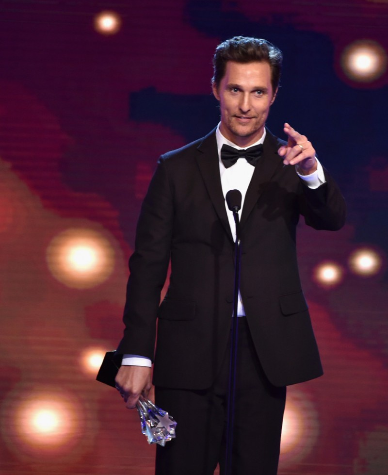 Actor Matthew McConaughey takes a break from Dolce & Gabbana, wearing a burgundy suit from Ermenegildo Zegna Couture to the Critics Choice Television Awards.
