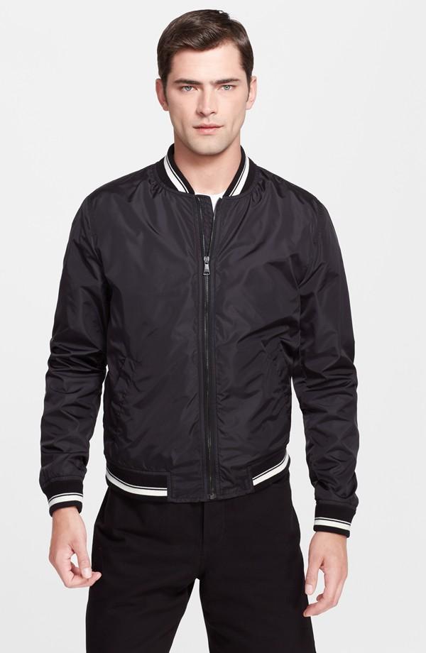 Sean O'Pry wears Dolce & Gabbana baseball jacket from Nordstrom