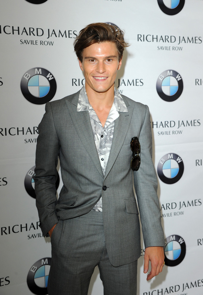 A man of style, model Oliver Cheshire impressed during London Collections: Men wearing a suit from Reiss with a printed shirt from Zara.