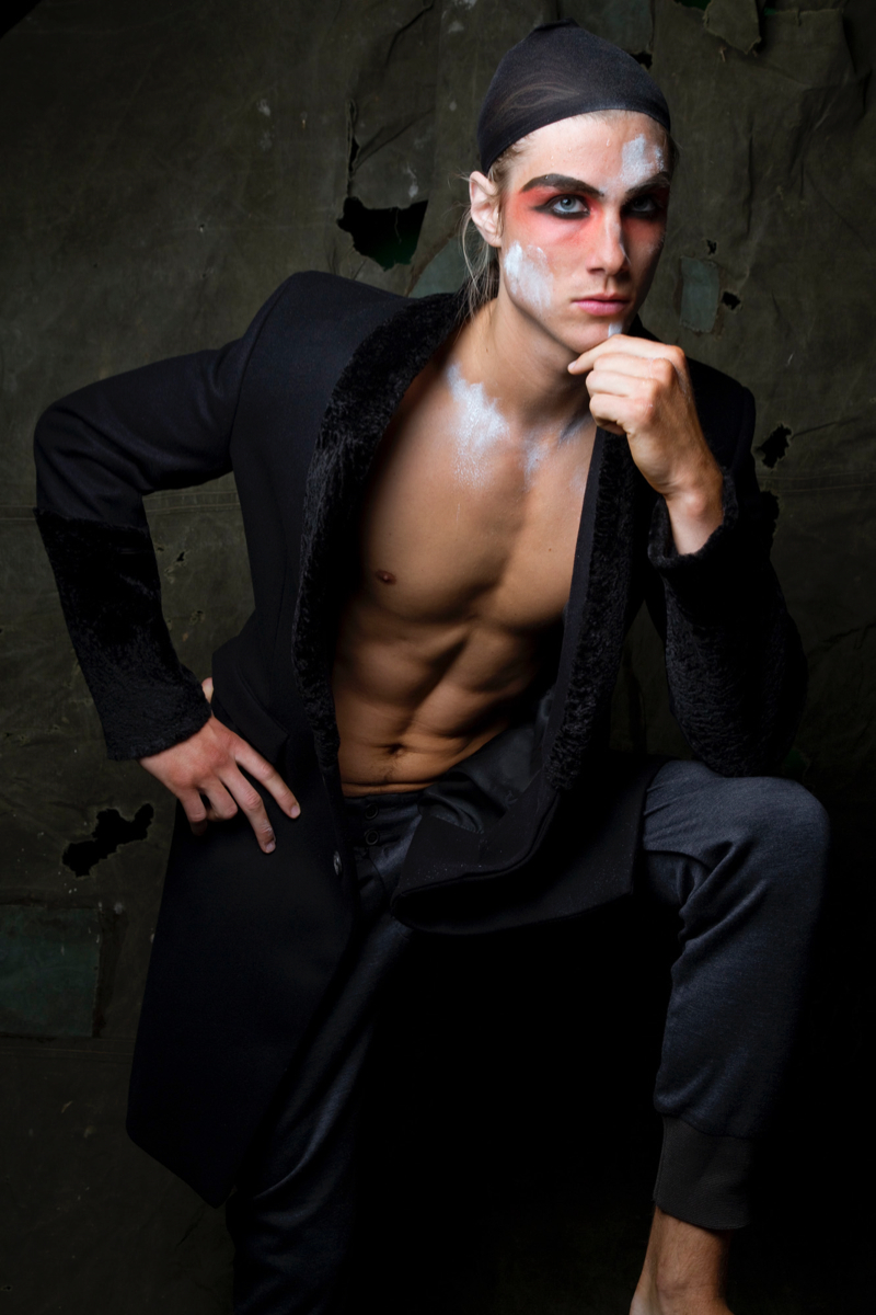 Dorian wears coat Roberto Cavalli and trousers Bottega Veneta.