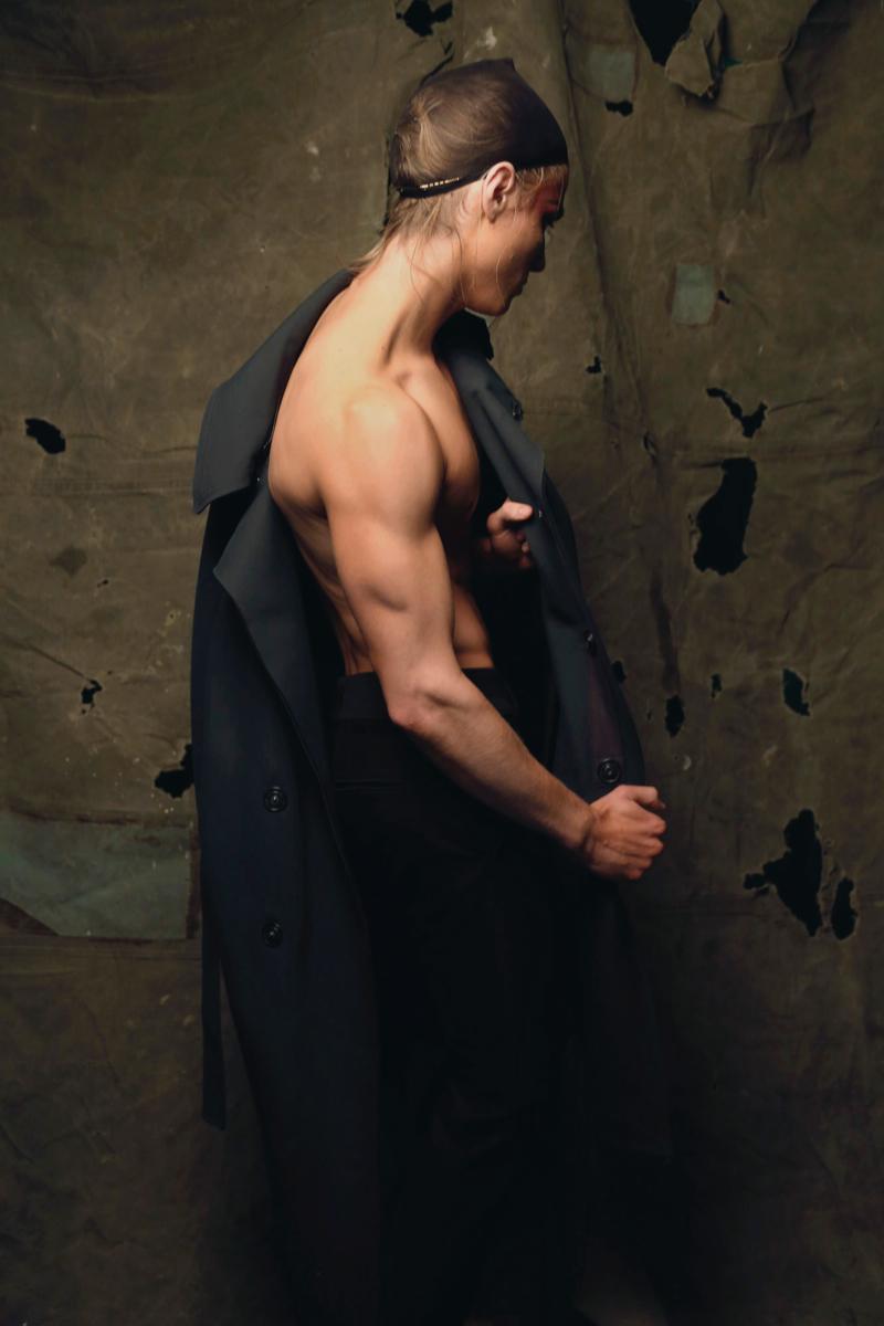 Dorian wears coat Lanvin and trousers Bottega Veneta.