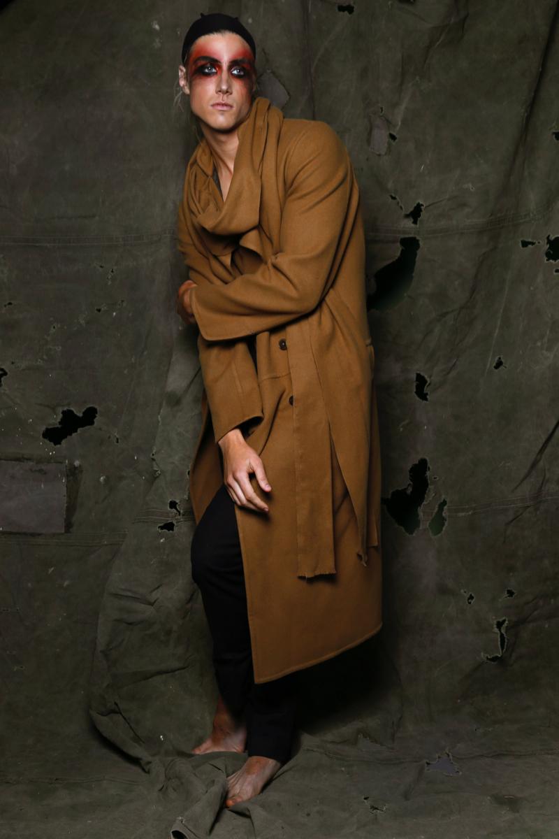 Dorian wears coat and trousers Ermenegildo Zegna.