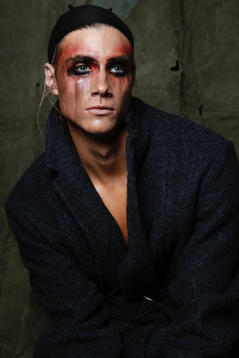 Dorian wears coat Dries Van Noten.