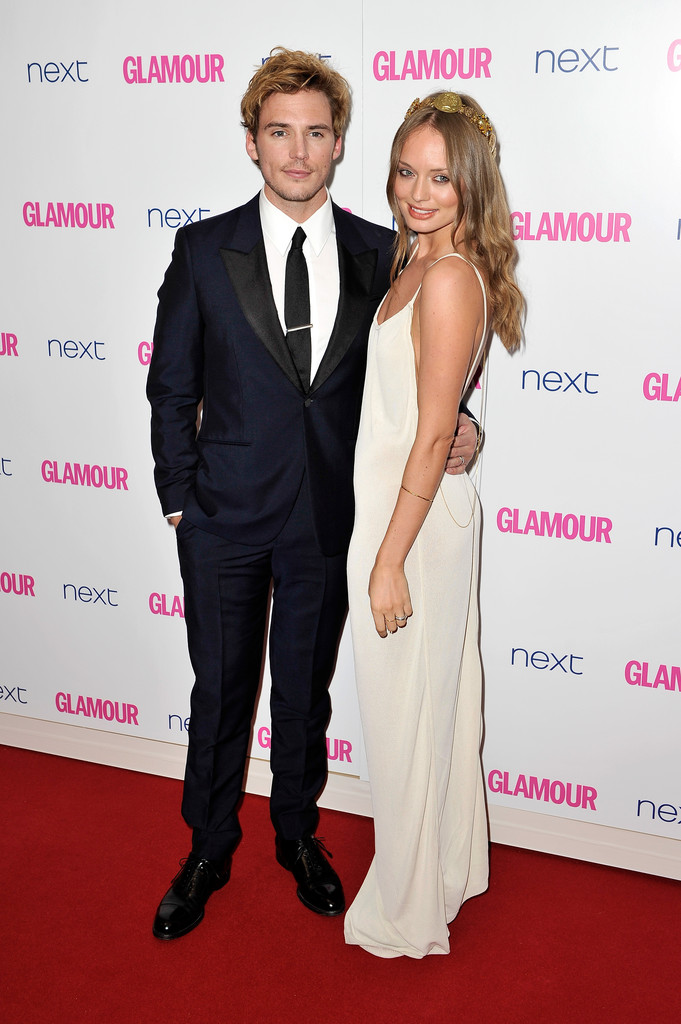 Actor Sam Clafin and Laura Haddock attend the Glamour Women of the Year Awards at Berkeley Square Gardens on June 3, 2014 in London, England.