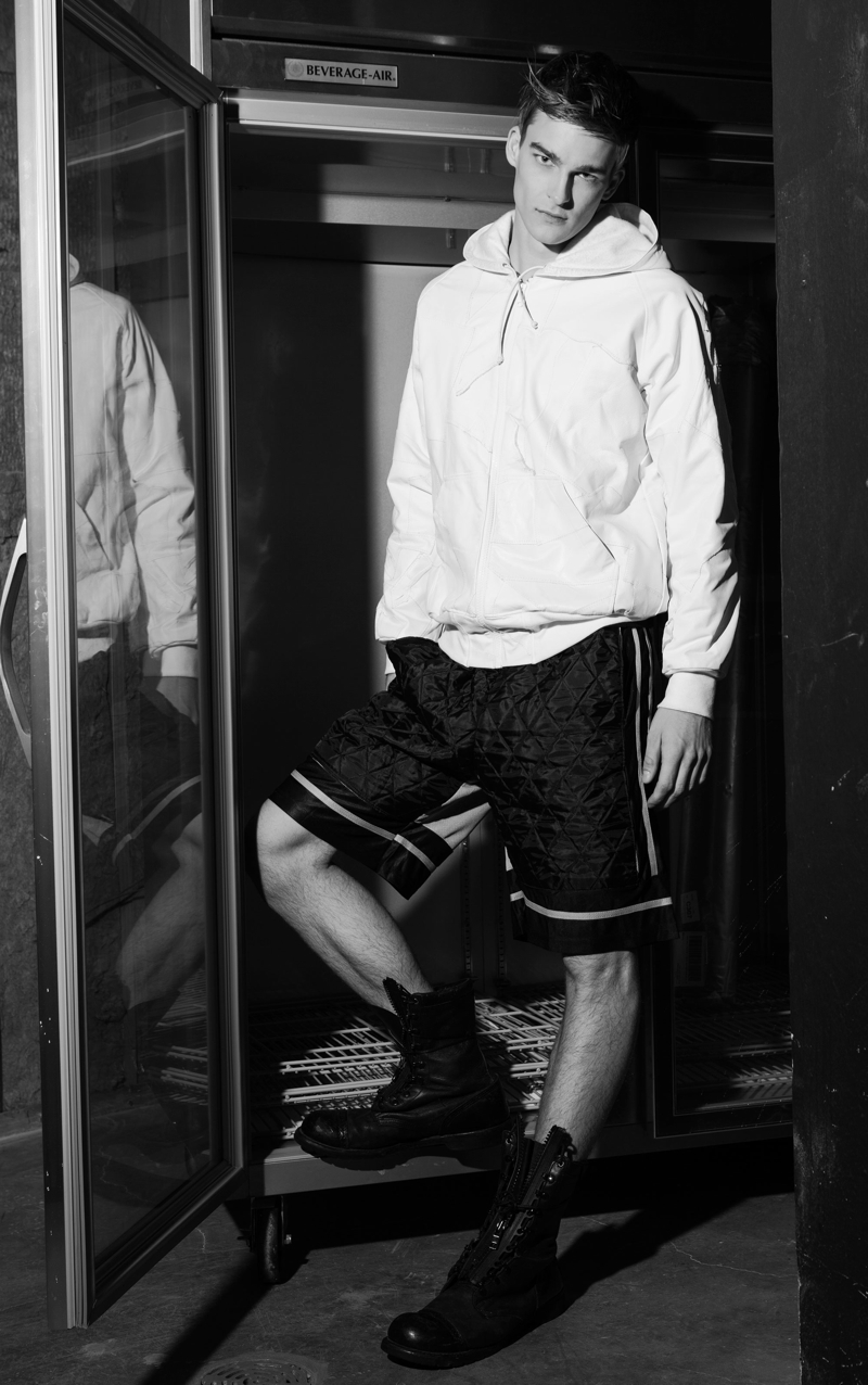 Thorben wears hooded leather pullover Martin Keehn and shorts Bobby Day.
