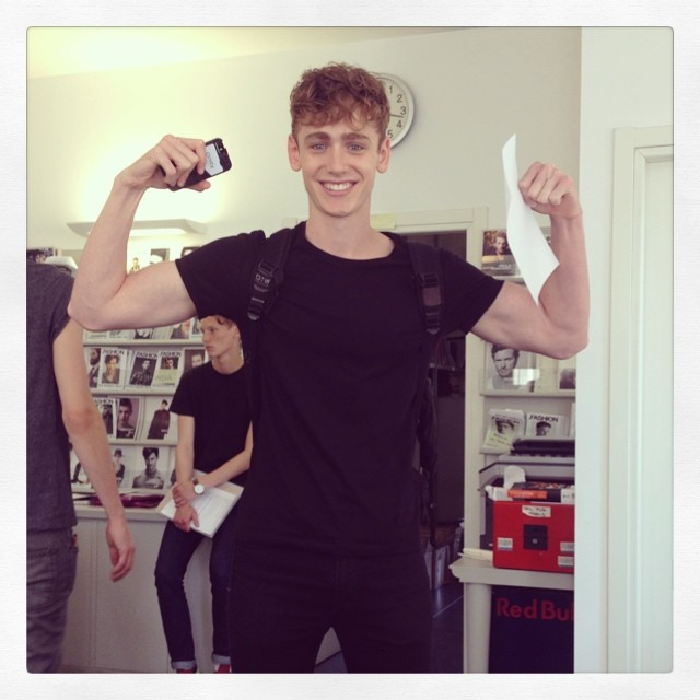 Tom Webb flexes his guns, fashion week excitement?