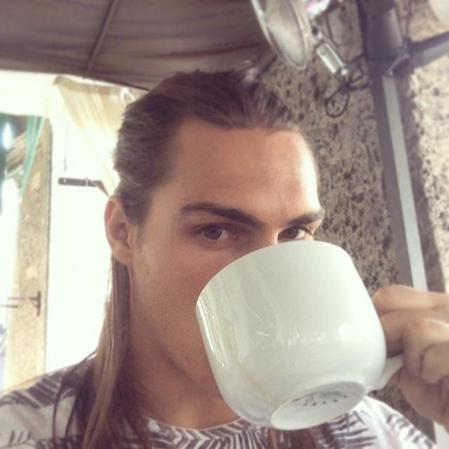 Travis Smith enjoys a morning cup of joe in Milan.