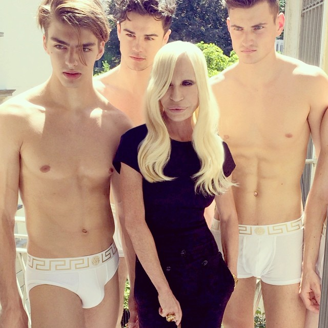 Donatella Versace prepares for her spring/summer 2015 shows. Versace poses with models wearing the label's luxe underwear.
