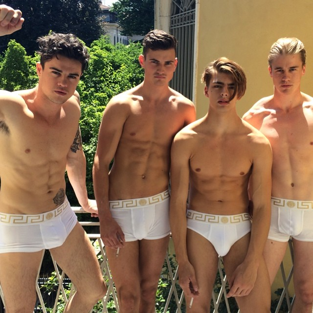 Models Jack Holland, Christian Williams, Dan van der Deen and Simo Kirk hang out at Versace headquarters.